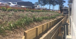 timber retaining wall by Hunnit Projects